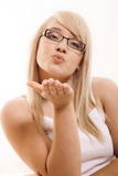Woman gesturing. Beautiful young woman gesturing indoor royalty free stock photography
