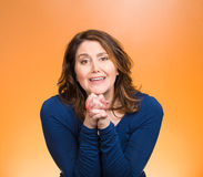 Woman gesturing with clasped hands, pretty please with sugar on top stock photography