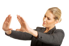 Woman gesturing frame Royalty Free Stock Photos