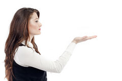 Woman gesturing with hand. Side portrait of young woman businesswoman gesturing with upturned hand, isolated on white background Stock Photos