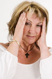 Woman gesturing headache Stock Image
