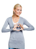 Woman gesturing heart with hands Royalty Free Stock Image