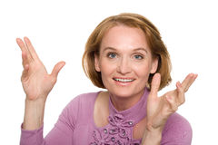 Woman gesturing with his hands gleefully. Beautiful middle aged woman gesturing with his hands gleefully Stock Photo