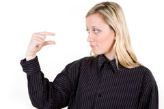 Woman gesturing little sign Royalty Free Stock Photography