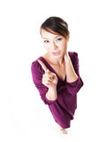 Woman gesturing no no no. Woman in a purple dress gesturing no no no from a top exaggerated angle Stock Image