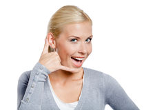 Woman gesturing phone call Royalty Free Stock Photo