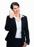 Woman gesturing a phone call sign isolated on Stock Images