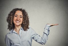 Woman gesturing, presenting copy space Stock Image