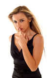 Woman Gesturing for Quiet. Young Woman Gesturing for Quiet or Shushing over white Stock Photo