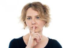 Woman gesturing silence, closeup shot Stock Photo