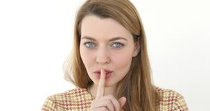 Woman Gesturing Silence Finger on Lips. Portrait of Middle Aged Woman Gesturing Silence, Finger on Lips Stock Images