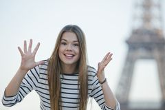 Woman gesturing and smiling. Young woman gesturing and smiling in Paris Stock Photography