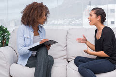 Woman gesturing and speaking to her therapist Stock Photos