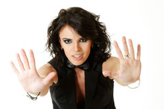 Woman gesturing STOP. Beautiful woman gesturing stop symbol with hands isolated Stock Images
