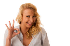 Woman gesturing success with her hand showing ok sign isolated o Royalty Free Stock Photos
