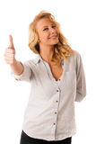 Woman gesturing success with her hand showing ok sign thumb up i Stock Photos