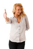 Woman gesturing success with her hand showing ok sign thumb up i Royalty Free Stock Photos