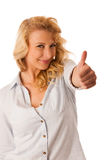 Woman gesturing success with her hand showing ok sign thumb up i Stock Images