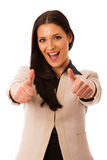 Woman gesturing success with thumbs up and big happy smile. Woman gesturing success with thumbs up and big happy smile royalty free stock photos
