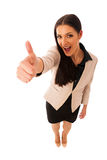 Woman gesturing success with thumbs up and big happy smile. Stock Photo