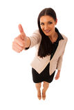 Woman gesturing success with thumbs up and big happy smile. Royalty Free Stock Photo