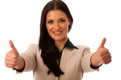 Woman gesturing success with thumbs up and big happy smile. Woman gesturing success with thumbs up and big happy smile isolated over white stock photography