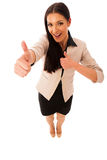 Woman gesturing success with thumbs up and big happy smile. Woman standing and gesturing success with thumbs up and big happy smile stock image