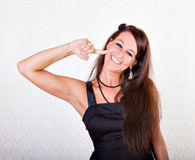 Woman gesturing taste good Royalty Free Stock Photography