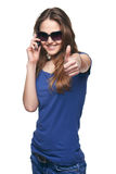 Woman gesturing thumb up while talking on cell phone Stock Photography