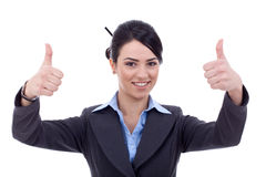 Woman gesturing thumbs up sign Stock Image