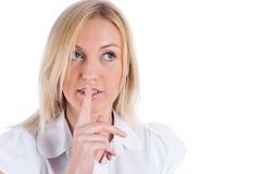 Woman gesturing to silence Stock Images