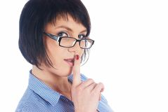 Woman gesturing to silence Stock Photo