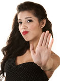 Woman Gesturing to Stop. Serious beautiful young woman gesturing stop with hand Royalty Free Stock Photos