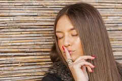 Woman gesturing us to be quiet Royalty Free Stock Images