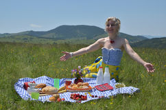 Woman Gesturing Welcome to Picnic Stock Images