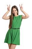 Woman gesturing winner sign Royalty Free Stock Photos