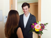 Woman get bunch of flowers from her husband Royalty Free Stock Photography