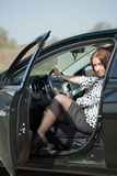 Woman get in the car Stock Images