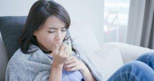 Sick woman drink hot tea stock photos