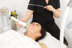 Woman get face treatment at beauty spa Royalty Free Stock Images