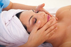 Woman get facial massage at spa. Close up of woman getting facial massage at spa retreat stock images