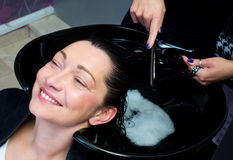 Woman get hair washing and combing Royalty Free Stock Images