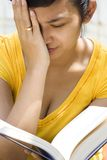 Woman get headache while reading book royalty free stock photos