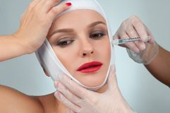 Beautiful woman after plastic surgery with bandaged face. Beauty, Fashion and Plastic Surgery concept Stock Photography
