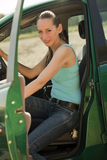 Woman get out of the car Royalty Free Stock Images