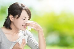 Woman blowing nose stock images