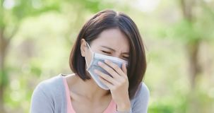 Woman get sick. And cough in the forest stock photo
