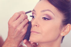 Woman geting make-up on Royalty Free Stock Photo