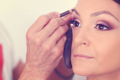 Woman geting make-up on Royalty Free Stock Images