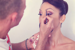 Woman geting make-up on Stock Images